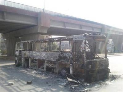 A burnt bus which belonged to forces loyal to Syria President Bashar Al Assad is seen at Aleppo's district of al Sakhour